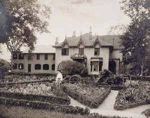 Constance Holt in the Parterre Garden at Roseland Cottage, about 1920 Woodstock, Connecticut